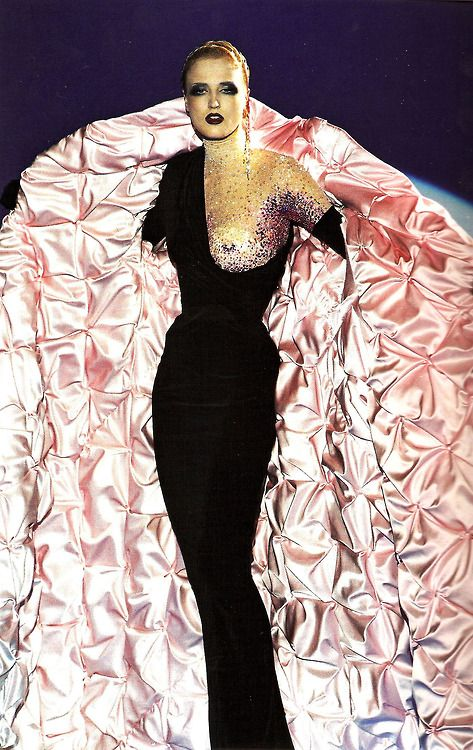 Radana Kasparova wears a full-length black velvet gown with demi-bodice embroidered with sequins and crystals in shades of ruby, red, and pink, under a black velvet cloak with oversized shawl collar, lined with quilted pink satin, with long black velvet gloves. Embroidery by Vermont, jewelry by Goossens. Thierry Mugler 'As Big as the Ritz' Couture Collection. Autumn/Winter 1998-99. Photo by Patrice Stable