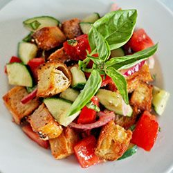 panzanella with tomatoes, cucumbers, and pickled red onions.
