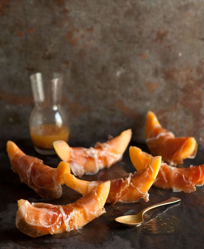 Prosciutto wrapped melon with a honey mustard vinaigrette