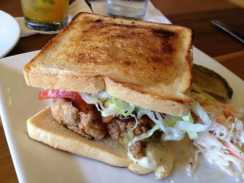 Oyster & bacon sandwich. Fried oysters, bacon, tomatoes, lettuce, mayo ...