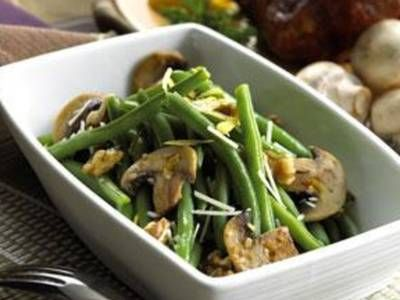 Fresh green beans are mixed with cooked mushrooms and topped with ...