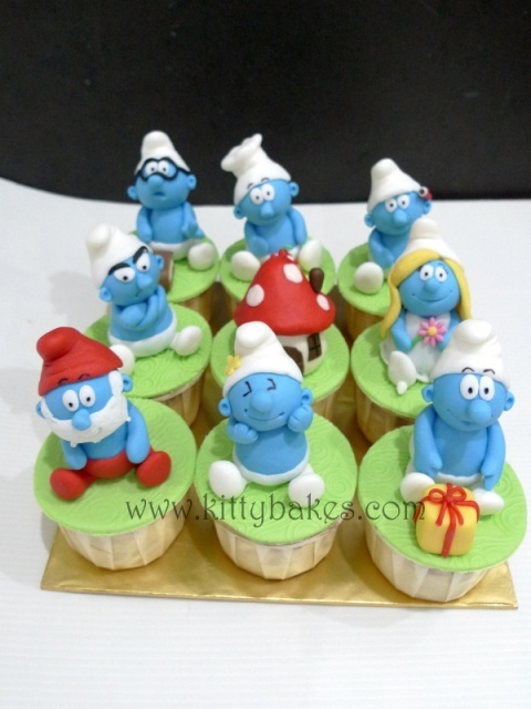 My first Smurfs cupcake set :) by Kitty Bakes, via Flickr