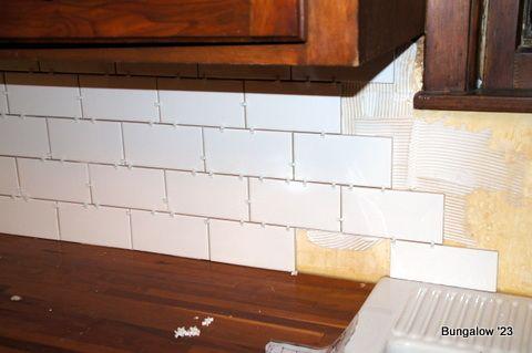 installing subway tile backsplash rehab projects pinterest