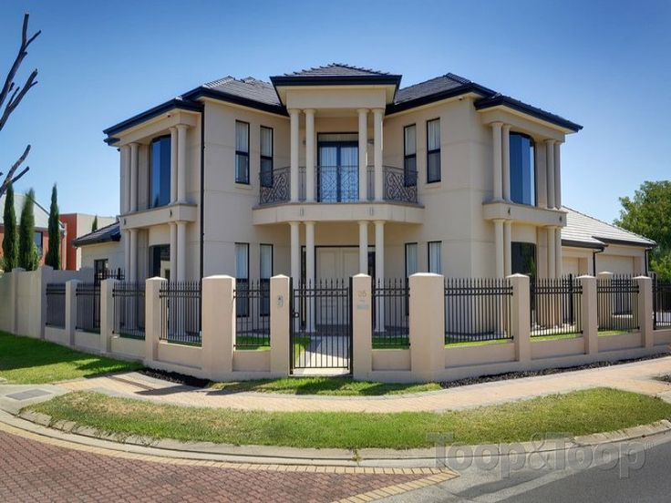 Classic balcony rendered two storey view house design for Double storey house plans with balcony