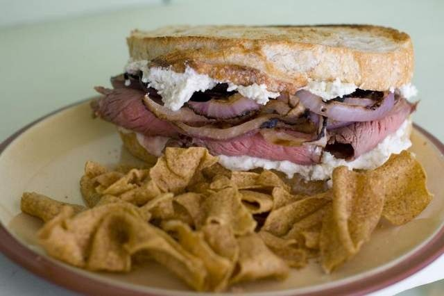 Guinness-Marinated Flank Steak Sandwiches with Grilled Onions and ...