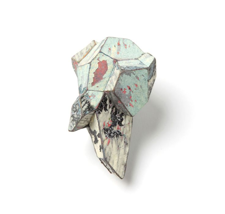 Carina Chistaz-Shoshtary Brooch: Stained 6 Graffiti, silver, stainless steel Graffiti paint taken from a Graffiti wall, divided in fine layers, form hollowly built, form made strong with layer of bioresin inside --  The Parallel Worlds.