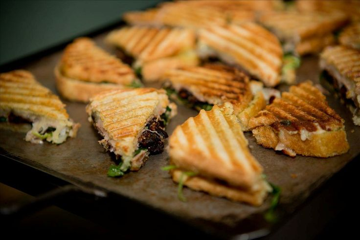 ... Panini with arugula, prosciutto, brie cheese and Mission Valley figs