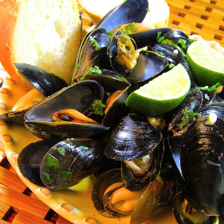 batch of Thai Steamed Mussels swimming in a delicious coconut-curry ...