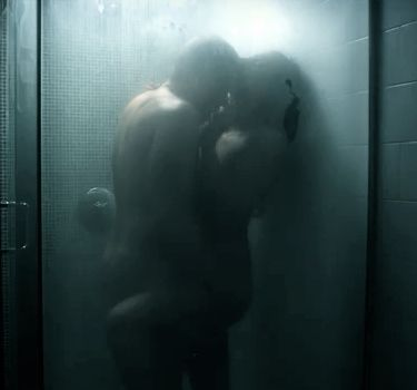 couple making wild love in shower