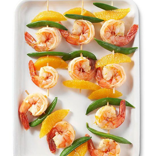Marinaded ginger shrimp skewers with pea pods and mandarin oranges
