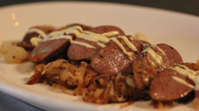 ... food menu Polidori german sausage with sauerkraut & carmelized onions