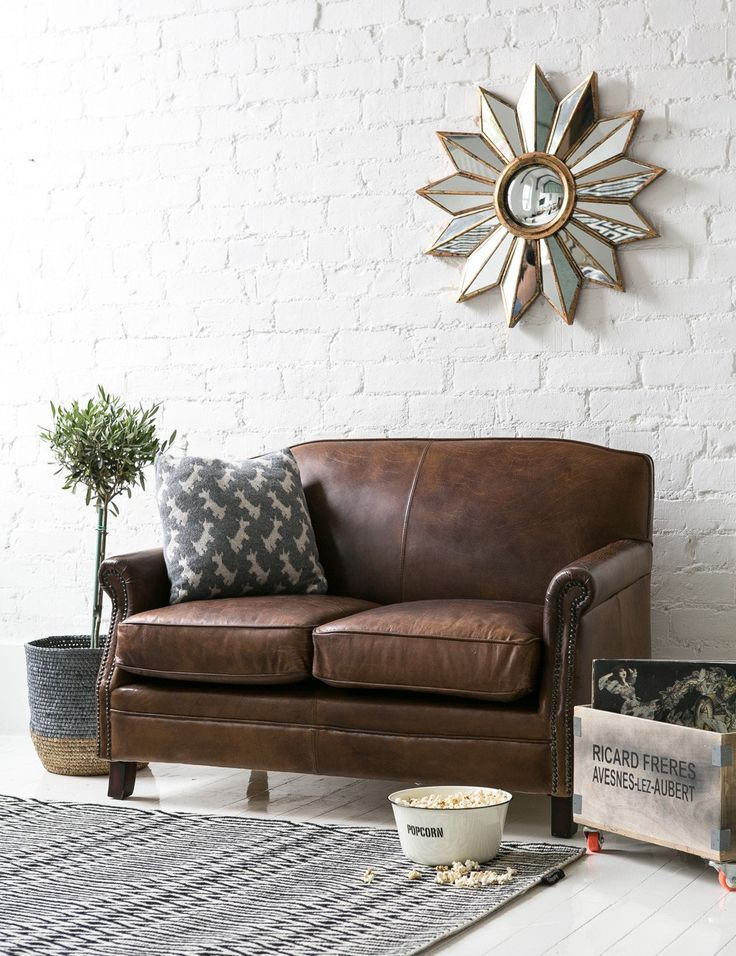 Amazing brown leather loveseat couch | Friday Favorites at www.andersonandgrant.com