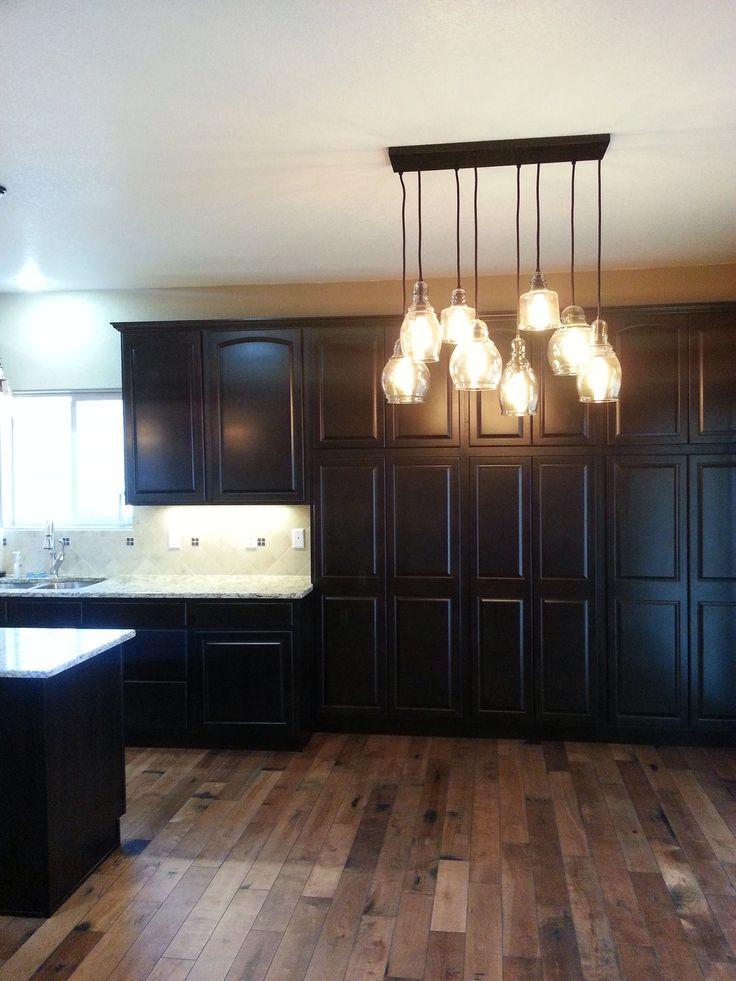 Dark cabinets wood floor light granite house ideas for Dark cabinets light granite