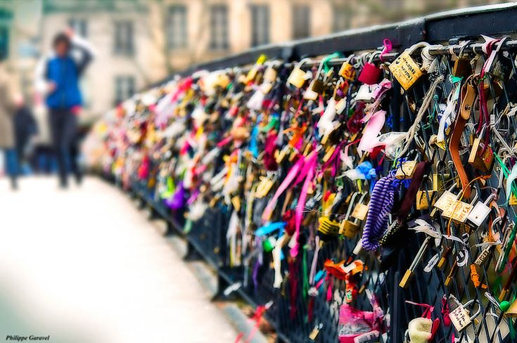 The Lovers Bridge in Paris. Couples attach a padlock to the bridge and throw the key into the river symbolizing their eternal love. This is now on my bucket list.