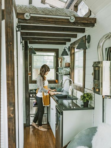Tiny Heirloom Homes....an incredible looking kitchen for such a small space!  (Via Country Living Magazine) | Friday Favorites from anderson + grant