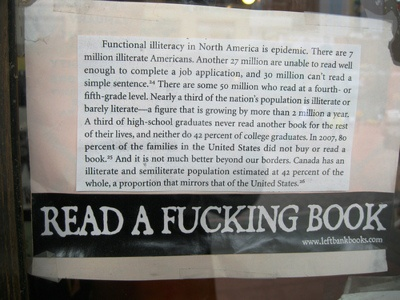 Sign in the window of Left Bank Books, Seattle