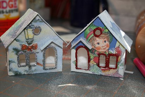 "http://christmasnotebook.com/2009/11/11/christmas-card-putz-houses/    ----   Christmas card putz houses    Putz houses, also called ""glitter houses,"" are little houses that make up a Christmas village. Popular from the 1920s on, they can be made from cardboard, card stock, and even old Christmas cards."