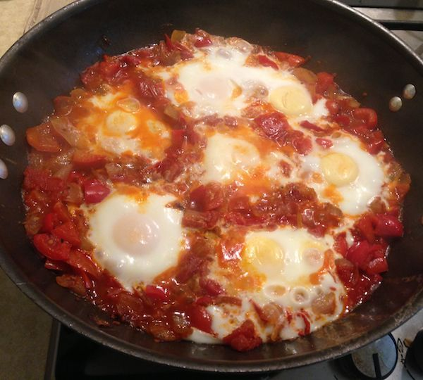 ... dish with eggs poached in tomato and pepper sauce (healthy, too