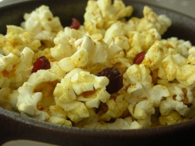 Curried Popcorn with Nuts and Cranberries