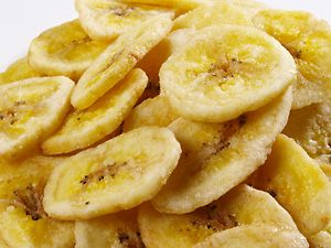 Slice banana into thin chips, dip in lemon juice, and spread on a cookie sheet. Bake for 2 hours @ 200 degrees and flip. Bake for another 1.5-2 hours or until crisp.