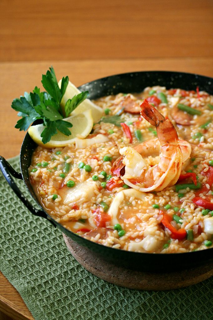Seafood Paella: saffron-infused rice simmered with a combination of ...
