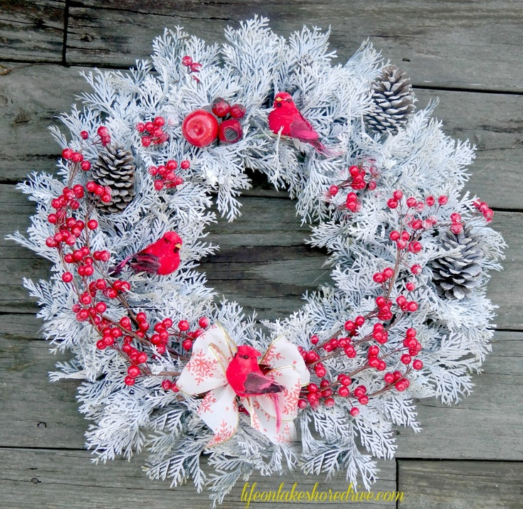 Winter red and white wreath with cardinals berries and pine cones