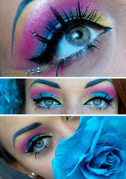 Crystals accent brilliantly colored pink, blue and yellow eye shadows with statement eye lashes.