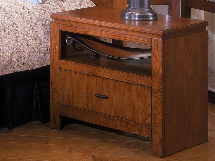 Store Accent Decor In A Nightstand Chest To Display Without Taking Up Bookshelf Space