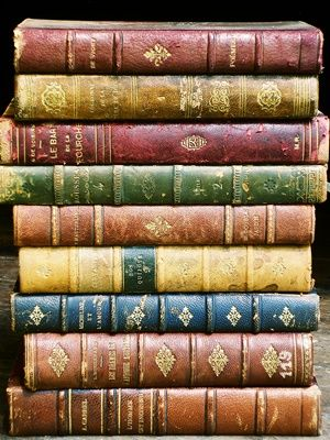 Stack of colourful old books.