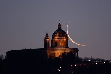 A slender old moon seems to be touching the top of this beautiful Italian church in this skywatcher image. The image was taken by Stefano De Rosa in Turin, Italy on Dec. 4, 2011.