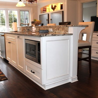 kitchen island with raised bar design of the home