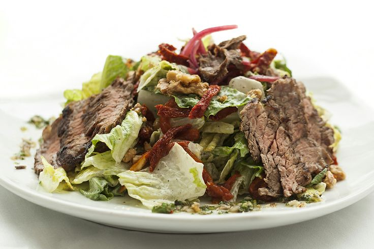 Grilled Chimichurri Marinated Steak Salad at Crocker Cafe by Supper Club: Hearts of romaine, sun dried tomatoes, fire roasted peppers, rosemary walnuts, hibiscus marinated red onions, tossed in a blue cheese dressing