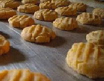 Cheese Wafers--Mix 12 oz of grated sharp cheddar; 2 sticks margarine ...