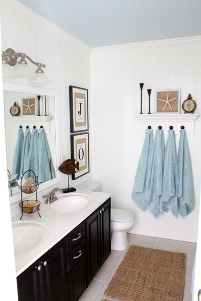 Gorgeous DIY coastal bathroom. Love the burlap monograms and creative knob towel rack.