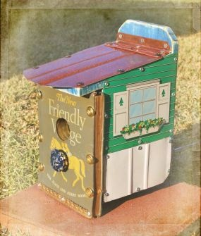 Vintage child's dollhouse and book used to make a birdhouse. Adorable.