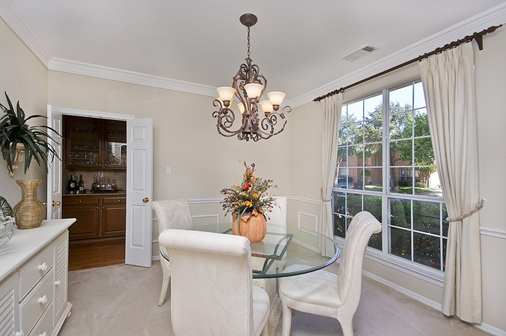 Formal dining room offered by jane clark realty group