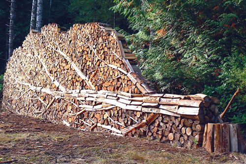 Stacked firewood sculpture by Alastair Heseltine