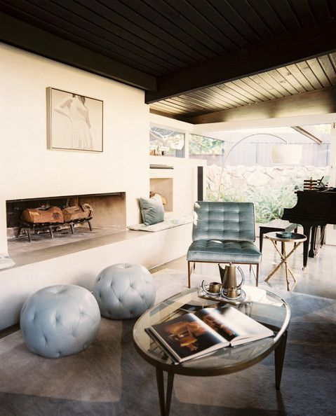 Living Room Photo - Two tufted poufs in front of a white fireplace