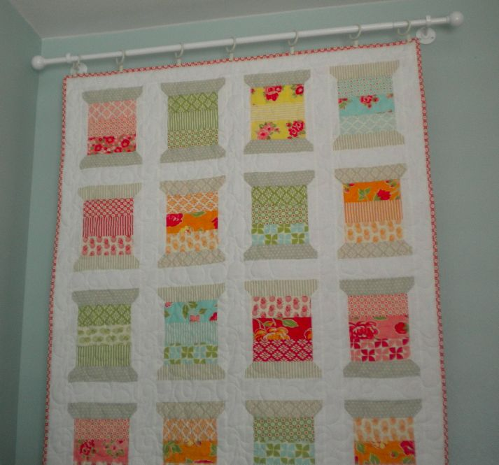 Hanging a quilt from curtain rod and cafe clips