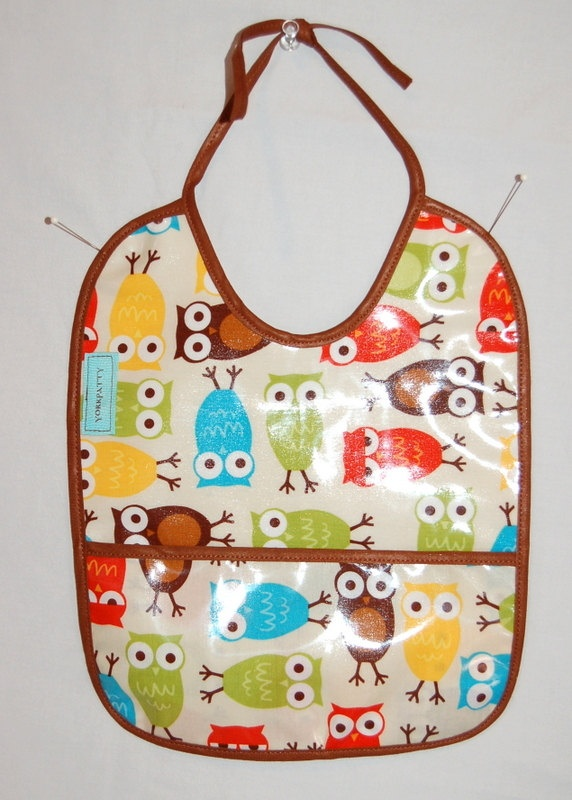 Whimsy Owl Vinyl Coated Bib -a local lady makes these/sells them at our local farmers market. They are beyond cute and look great on our baby! $10.00 (She sells on Etsy as well)