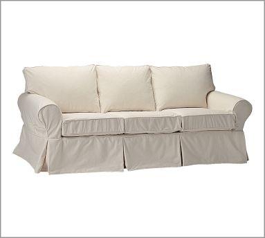 white slipcovered sofa Pottery Barn