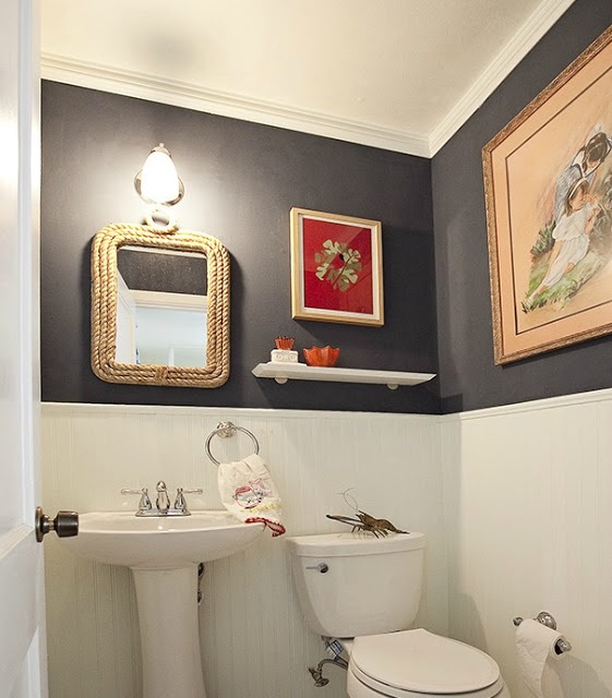 Preppy Nautical Bathroom. Wainscoting with crown molding. Dark blue wall.