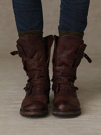 Leather boots with wrapped buckles.