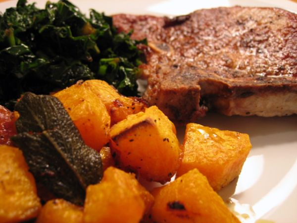 Roasted pork chops and butternut squash with kale