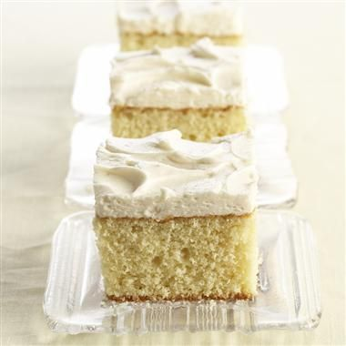 When you don't have time to prepare a layer cake, this 13x9-inch vanilla cake is the recipe for you. The Vanilla Buttercream Frosting makes it special. #recipe