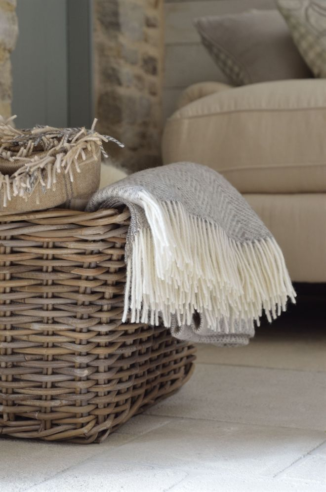 throws, ready for cool nights- I  roll mine up and put them vertically in the basket , it looks great ❤️