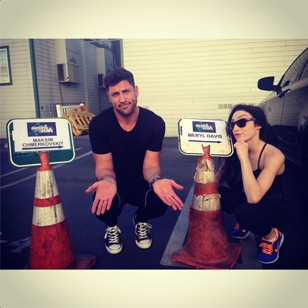 Maksim chmerkovskiy and meryl davis posing by their parking spots on