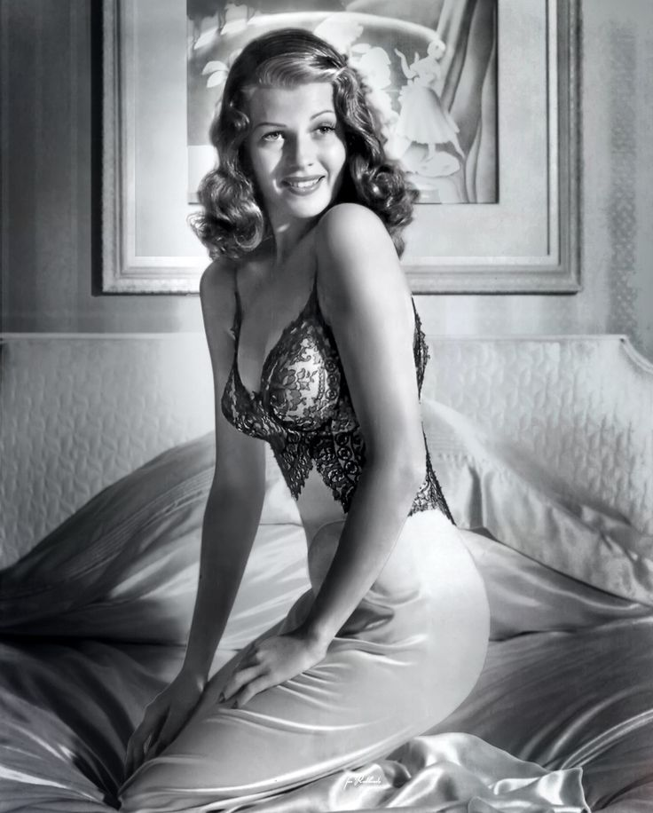Rita Hayworth pinup from the famous Bob Landry photoshoot for LIFE Magazine (1941). The image of Rita in the satin and lace nightgown made her one of the top two pin-up girls of World War II (the other being Betty Grable). Over five million copies were sent to soldiers, sailors and marines fighting in the war. (wikipedia)