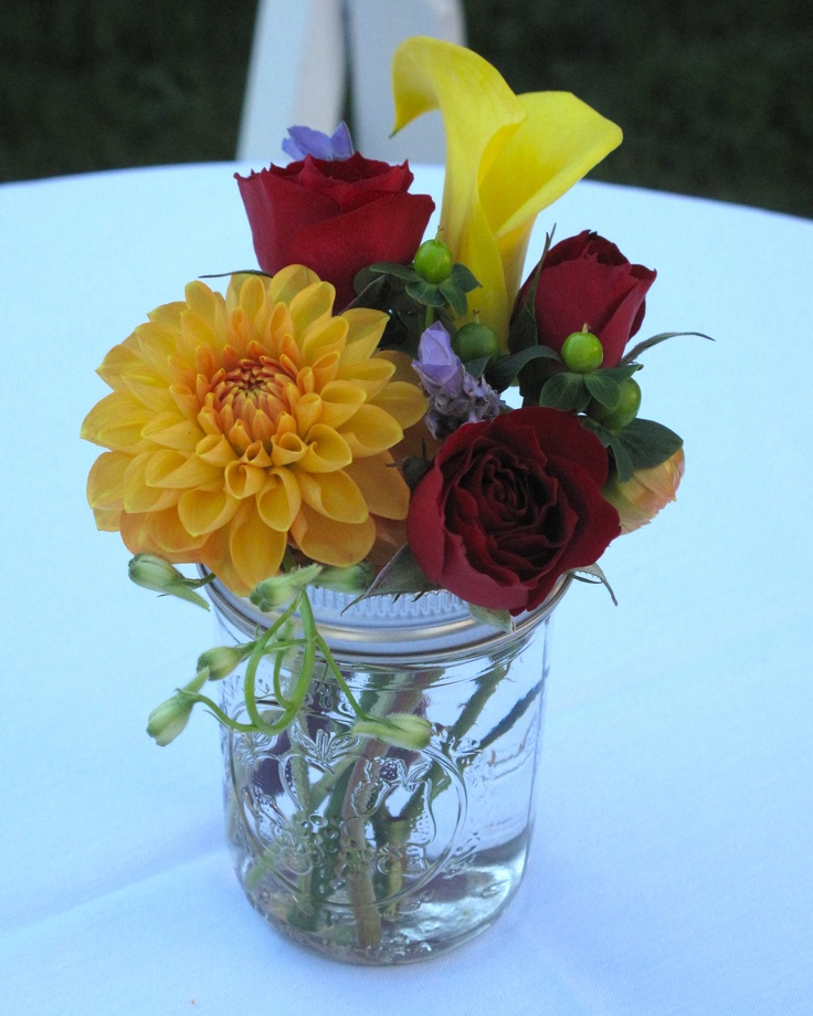 simple flower arrangements colors orange and yellow