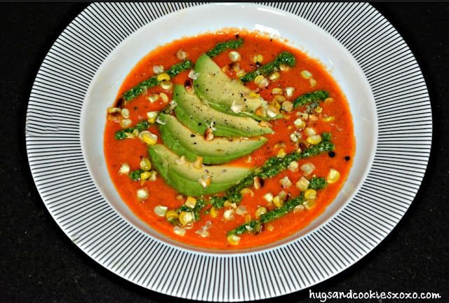 ROASTED CORN, TOMATO & PEPPER SOUP TOPPED WITH PESTO & AVOCADO